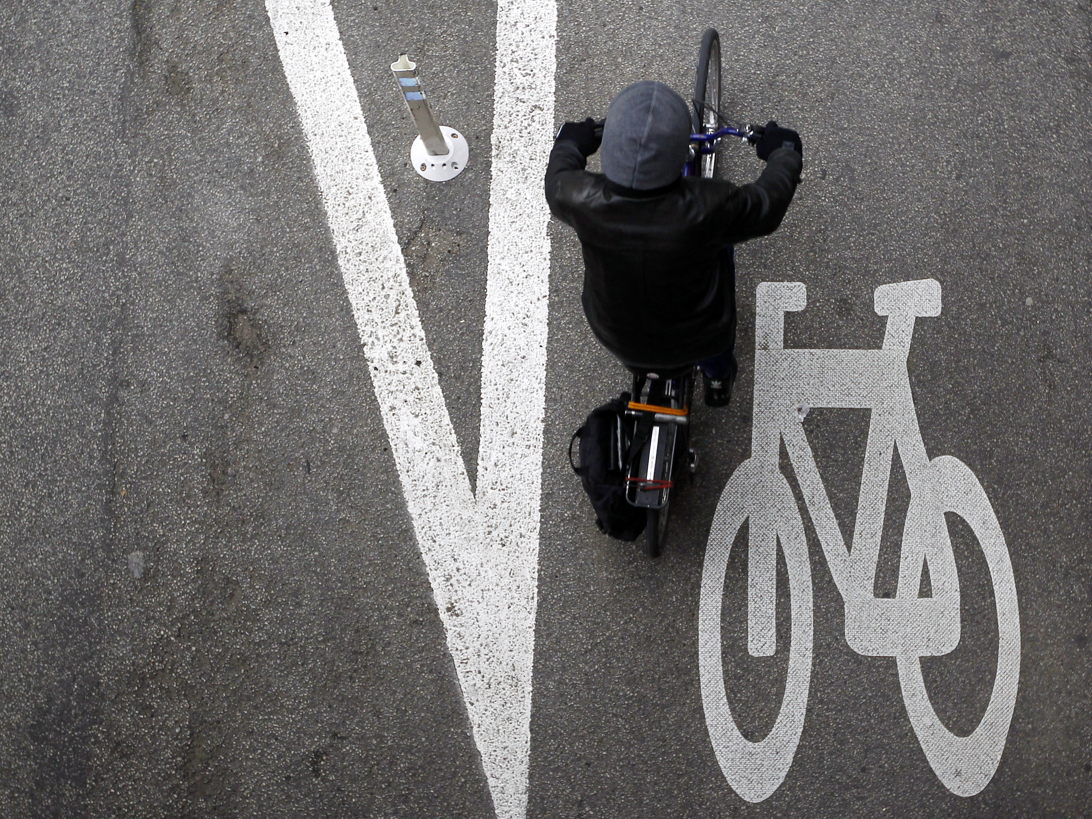 A cyclist rides along the Kinzie Protected Bike Lane in Chicago.