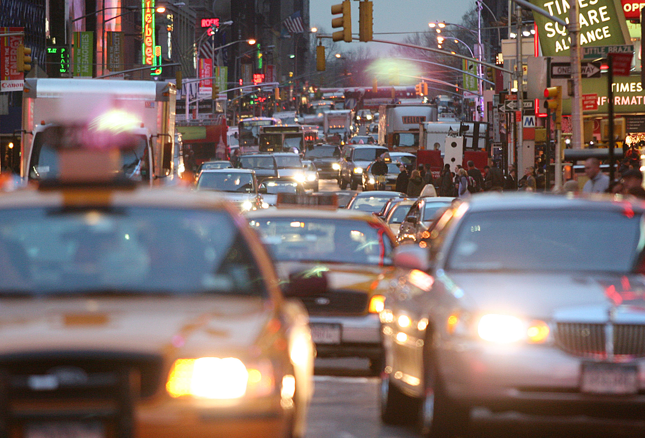 Cars squeeze into any space as they try to get though Time Square in new York City.