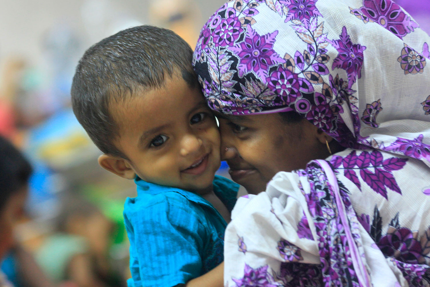 A mother plays with her thirteen-month old child Neerob, who is suffering from diarrhoea, at the International Centre for Diarrhoeal Disease & Research (ICDDRB), in Dhaka April 6, 2012.