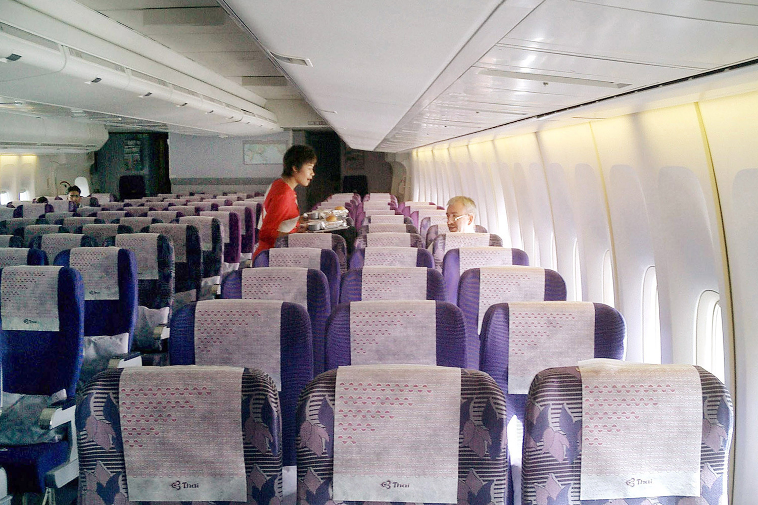 Photo shows an almost empty plane.