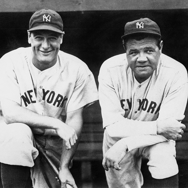 "Lou Gehrig, pictured with New York Yankees teammate Babe Ruth, was called the ""Iron Horse"" of baseball for playing in 2,130 consecutive games before his forced retirement from the game that loved him. The photo shows Lou Gherig in happier times leaning on one knee propped on a dugout bench next to the Babe. GETTY PHOTO."