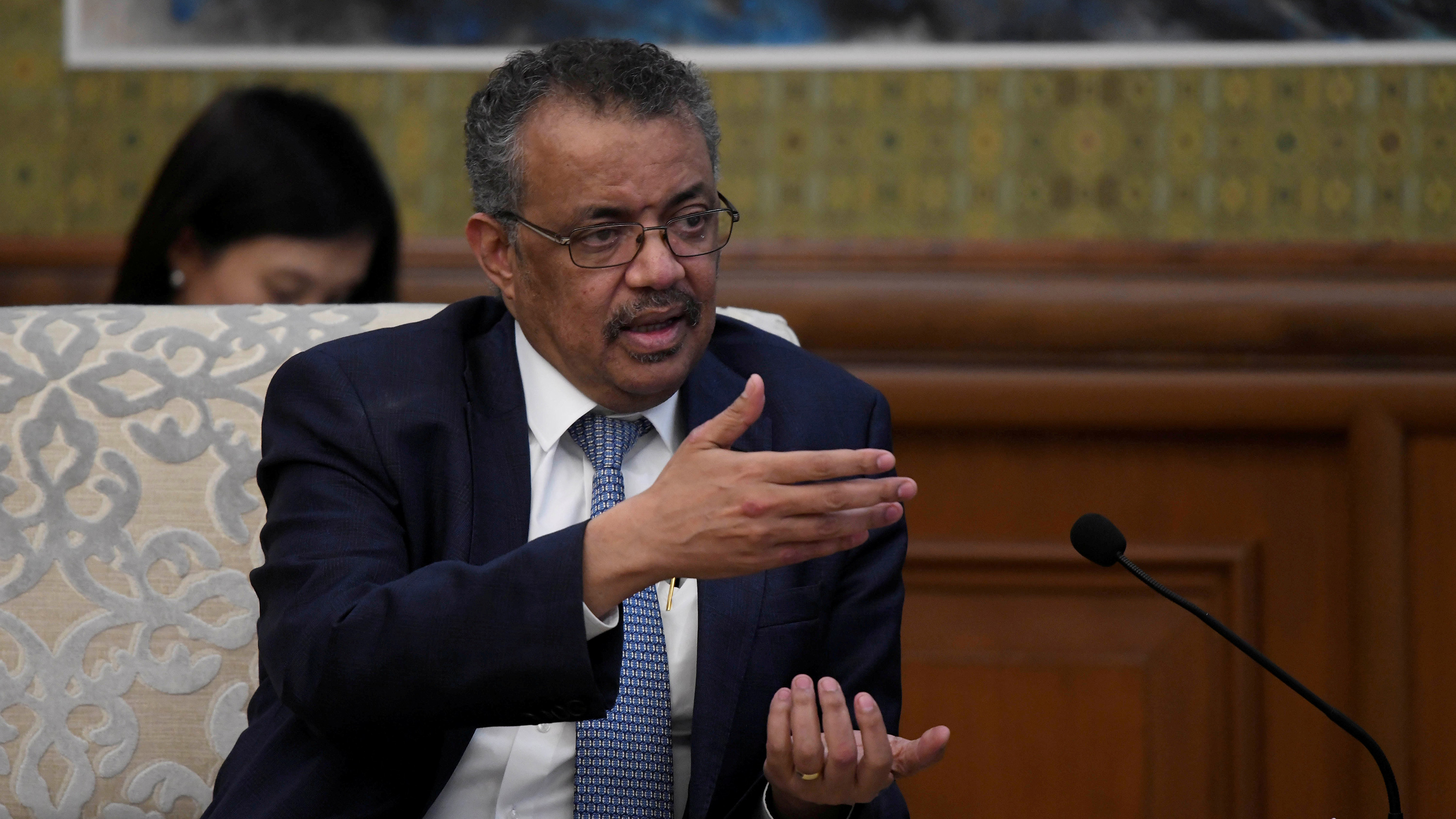 The photo shows Director-General Tedros talking and guesturing with his hands.