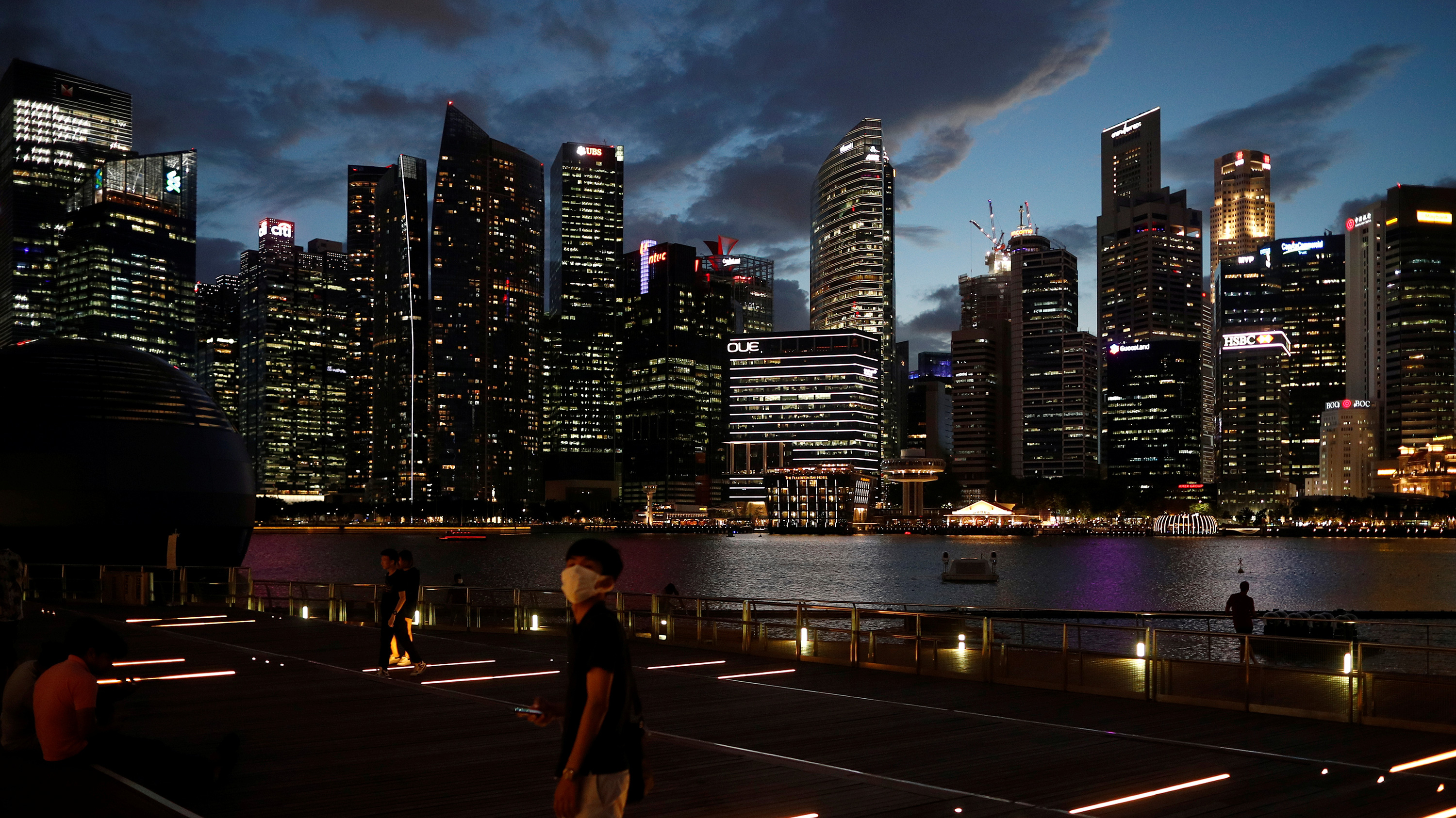 This is a stunning photo showing the Singapore skyline at dusk from across the water.