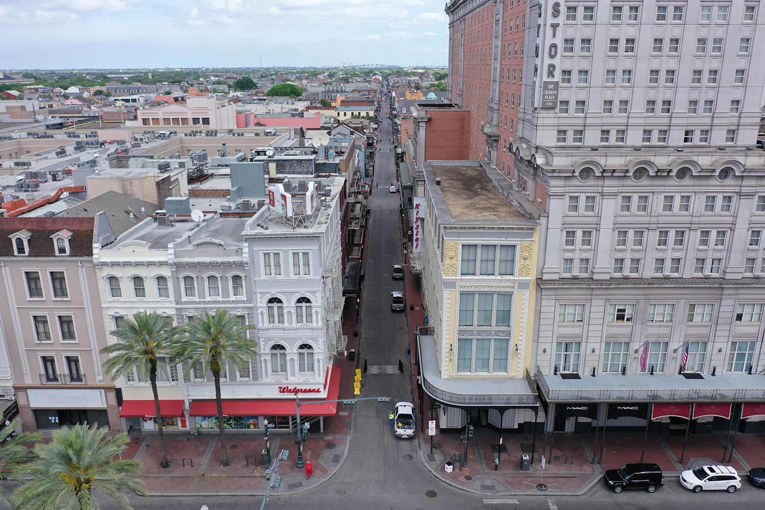 Normally bustling tourist mecca Bourbon Street lies deserted in the early afternoon during shelter in place orders to slow the spread of coronavirus in a photograph of New Orleans on March 27, 2020. The photo shows a view of the entrance to Bourbon street, which would normally be packed with tourists and other people, almost completely empty. REUTERS/Drone Base