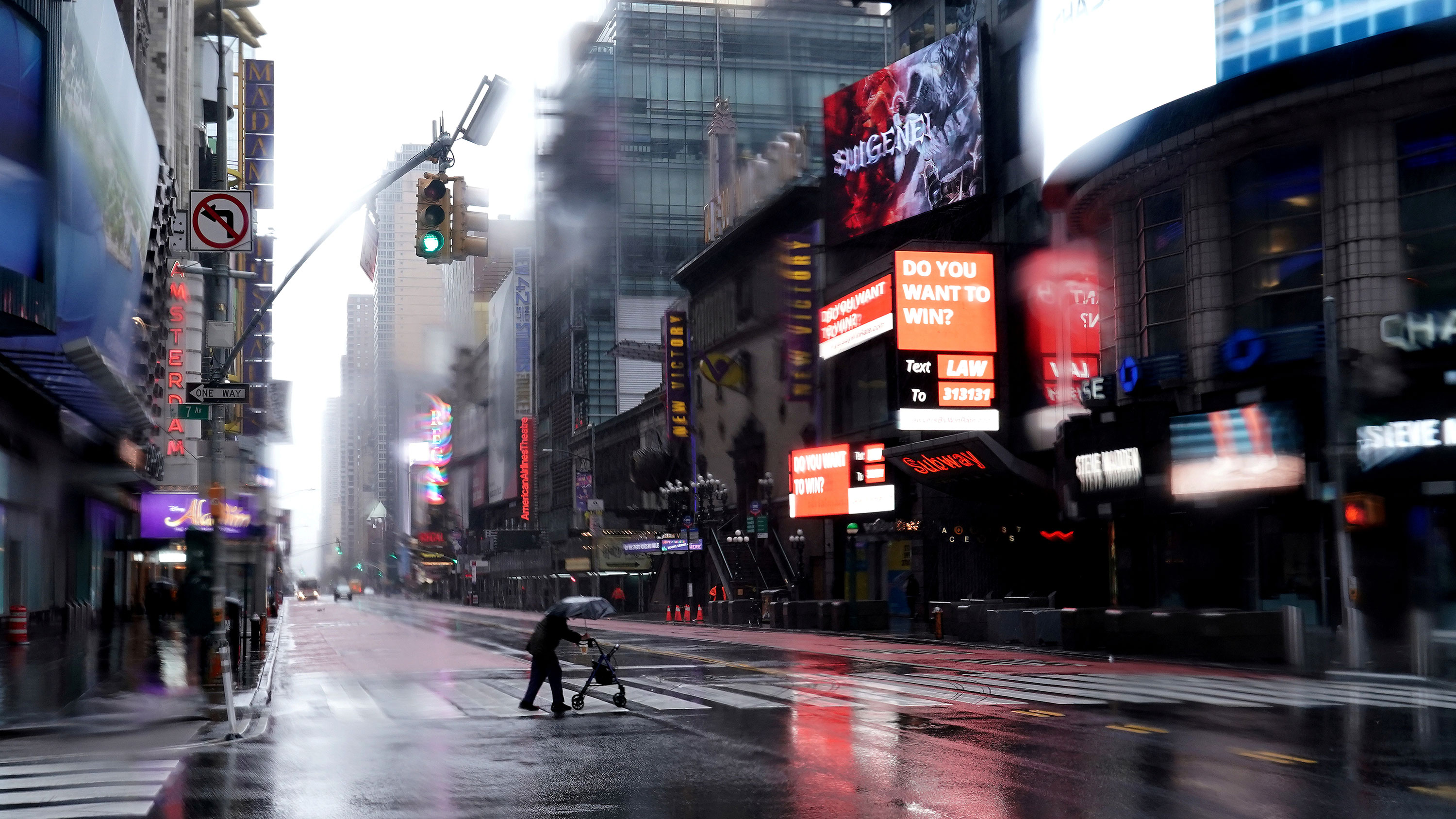 This is a striking photo of Times Square—New York in the Rain—as it's rarely been seen before: completely empty of cars and people.