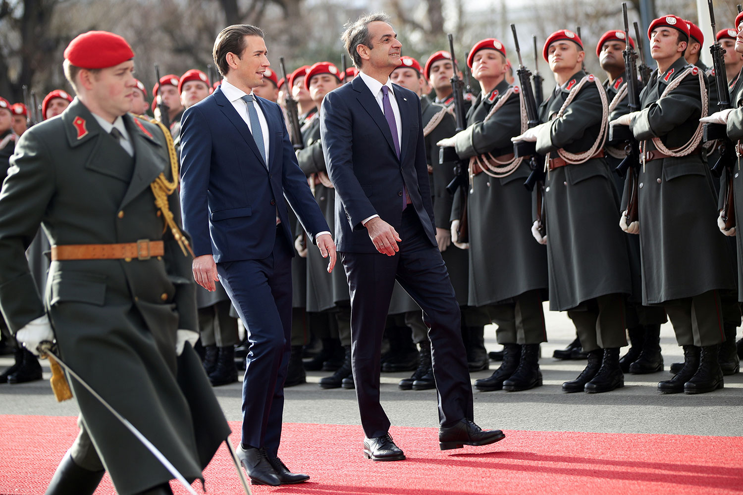 The photo shows the two leaders walking alongside a highly polished military guard.
