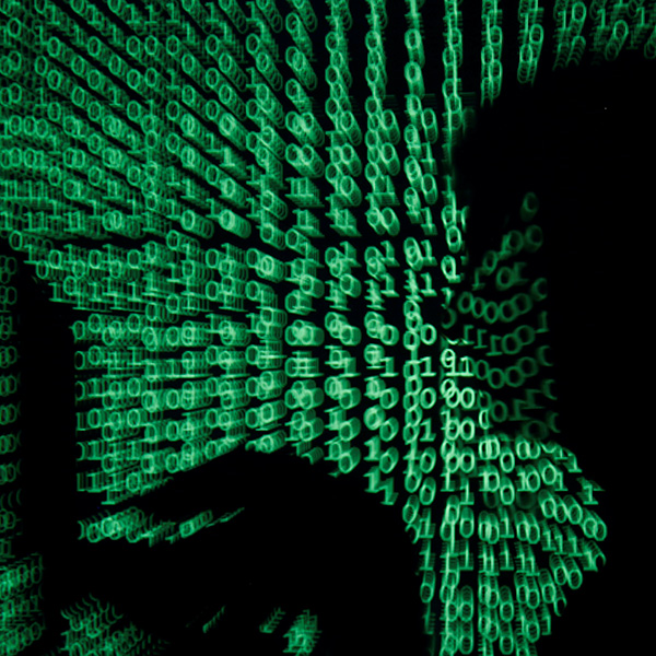 "We are facing a digital moment of truth as a result of the new coronavirus. A man holds a laptop computer as cyber code is projected on him in this illustration and picture produced on May 13, 2017. the image shows the silhouette of a man on a laptop with green ones and zeroes, reminiscent of the film ""The Matrix"" projected over the image. REUTERS/Kacper Pempel/Illustration"