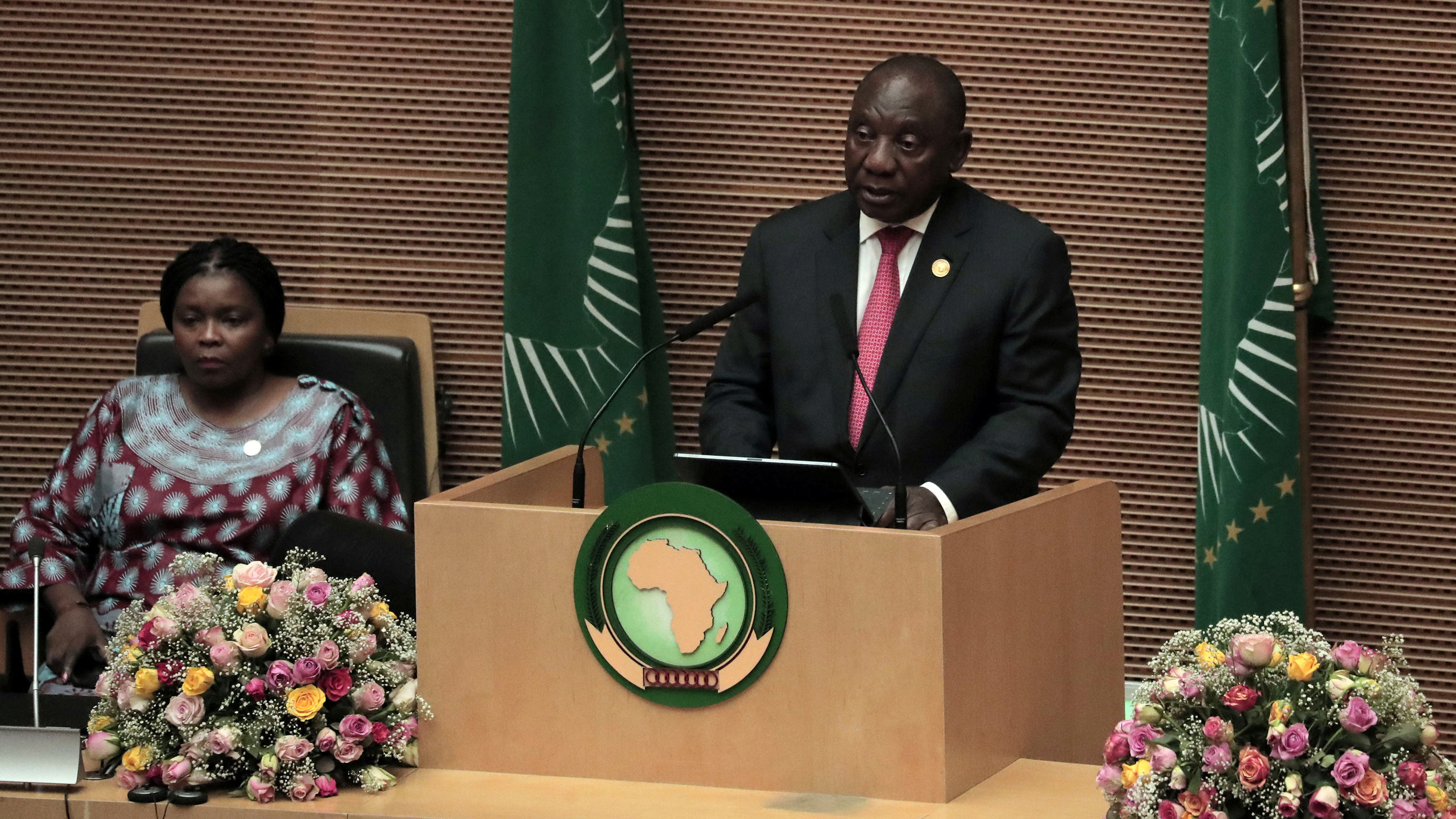 The photo shows the South African president at a podium speaking into a microphone.