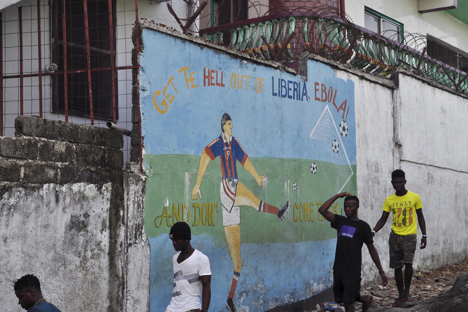 "The mural reads, ""Get the hell of Liberia, Ebola! And don't come back"""