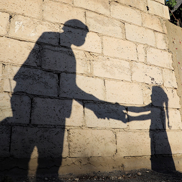 The shadow of a girl receiving an evening meal from a humanitarian service center is cast on a wall in front of her family home in Russeifa, Jordan, on April 28, 2020 during the coronavirus pandemic. Picture shows the girl's shadow on an old wall. REUTERS/Muhammad Hamed