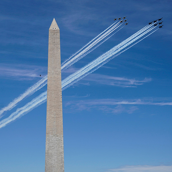 A formation of the Navy Blue Angels and Air Force Thunderbirds fly past the Washington Monument as a salute to first responders and essential personnel during the coronavirus pandemic on May 2, 2020. The photo shows two tight formations of several jets flying by the Washington monument on a brilliant blue sky day. REUTERS/Joshua Roberts