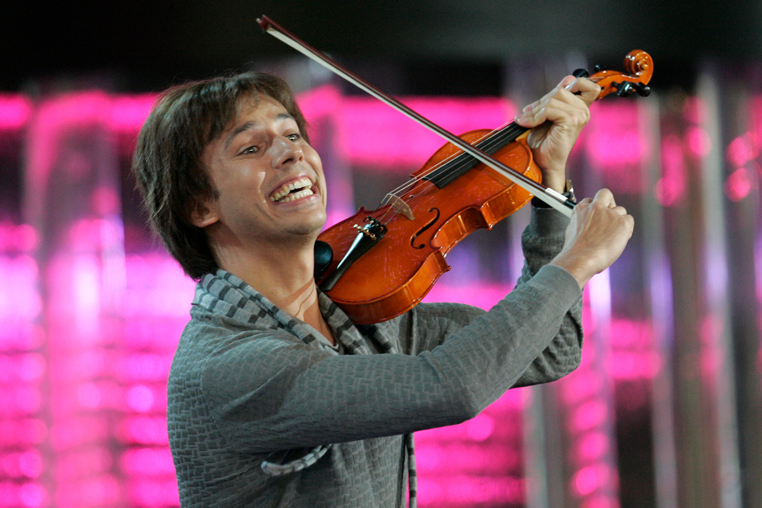 The photo shows the comedian hamming it up with a violin.