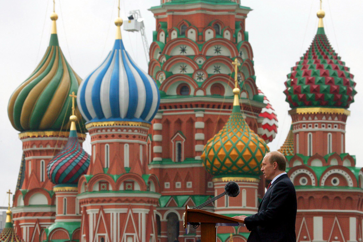 The photo shows Putin in profile in front of St.Basil's Cathedral in Red speaking at a podium.