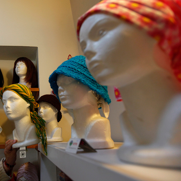 "Wigs and head scarves for patients with breast cancer are seen on mannequins at a center run by the ""Reto"" Group for Full Recovery of Breast Cancer in Mexico City October 18, 2012. The photo shows a room with mannequin heads and wigs. REUTERS/Edgard Garrido"