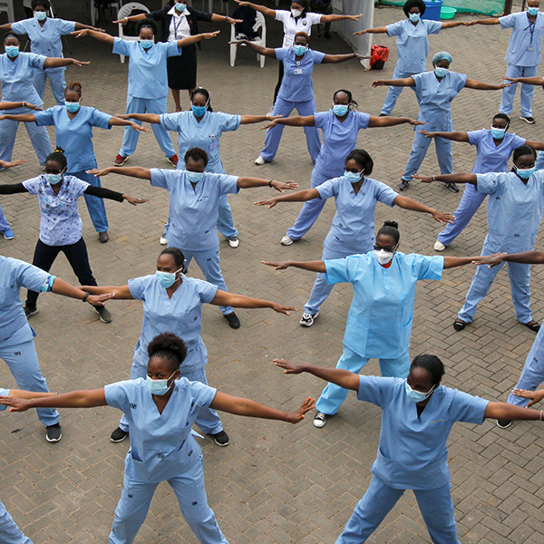 A call for funding community health alongside other types of health care—like the nurses who staff the national hospital in Nairobi, Kenya seen here during the coronavirus outbreak on May 28, 2020. The photo shows a field of nurses exercising in a field. REUTERS