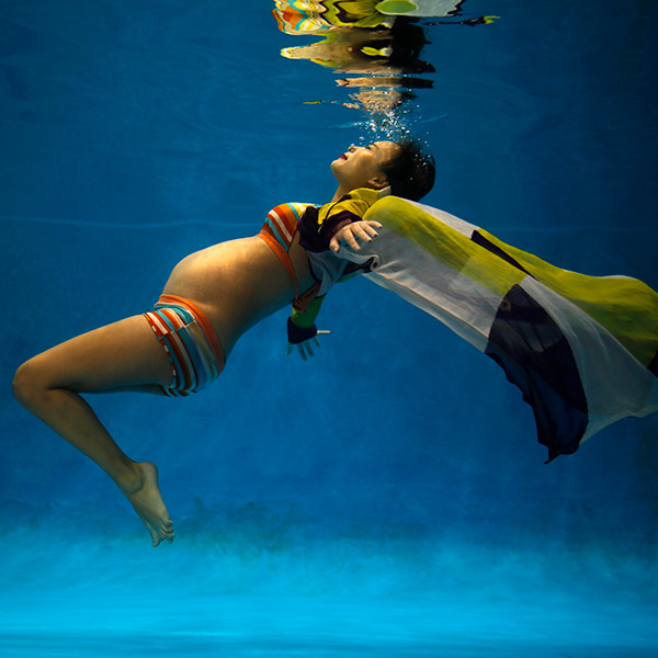 Jiejin Qiu, six months pregnant with her first baby, poses underwater during a photo shoot at a local wedding photo studio in Shanghai on September 5, 2014—as China began easing its one-child policy. The photo shows the expecting mother floating underwater in a dream-like shot. REUTERS/Carlos Barria