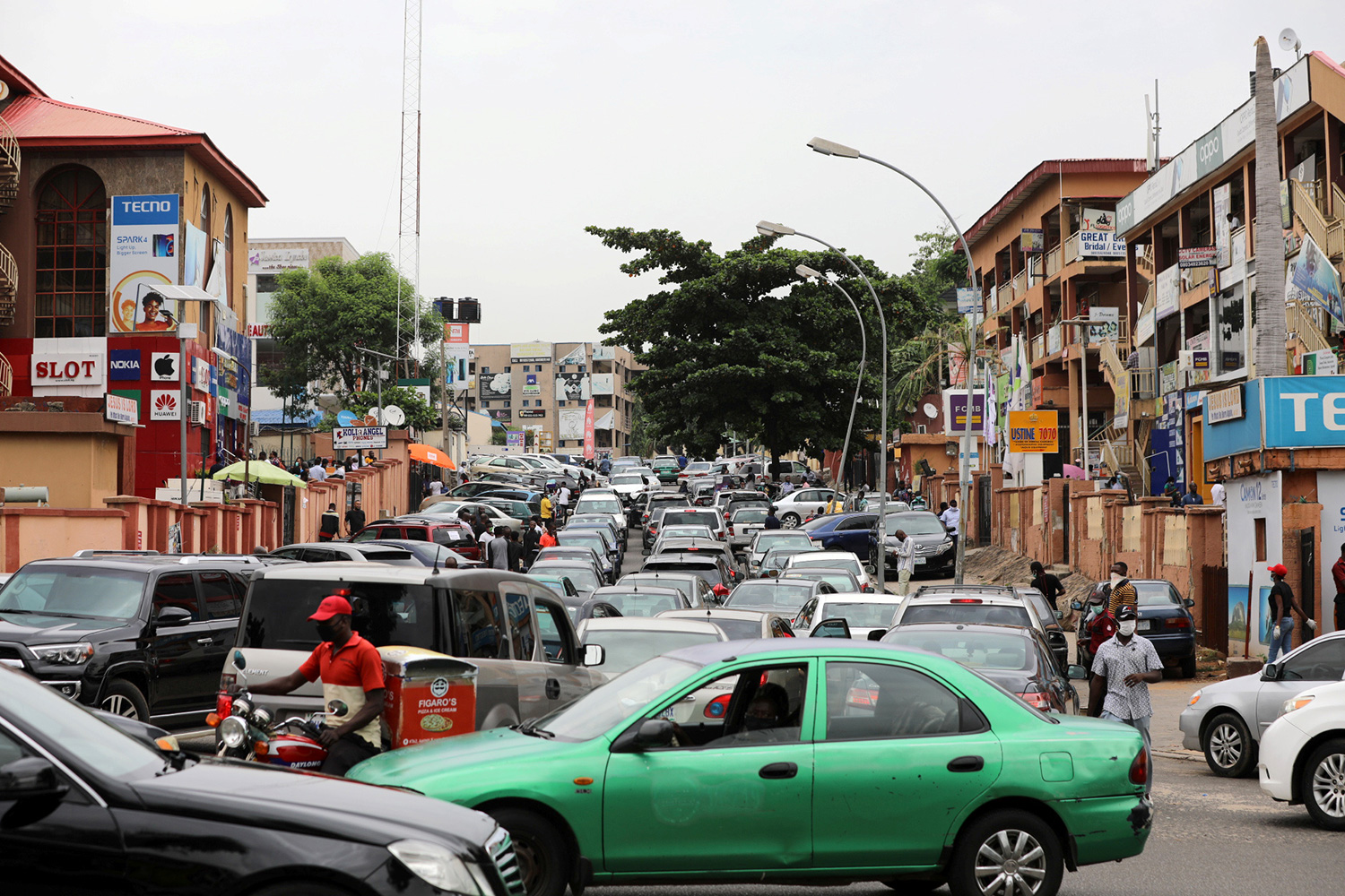 The photo shows a busy street locked in congestion of cars and traffic.