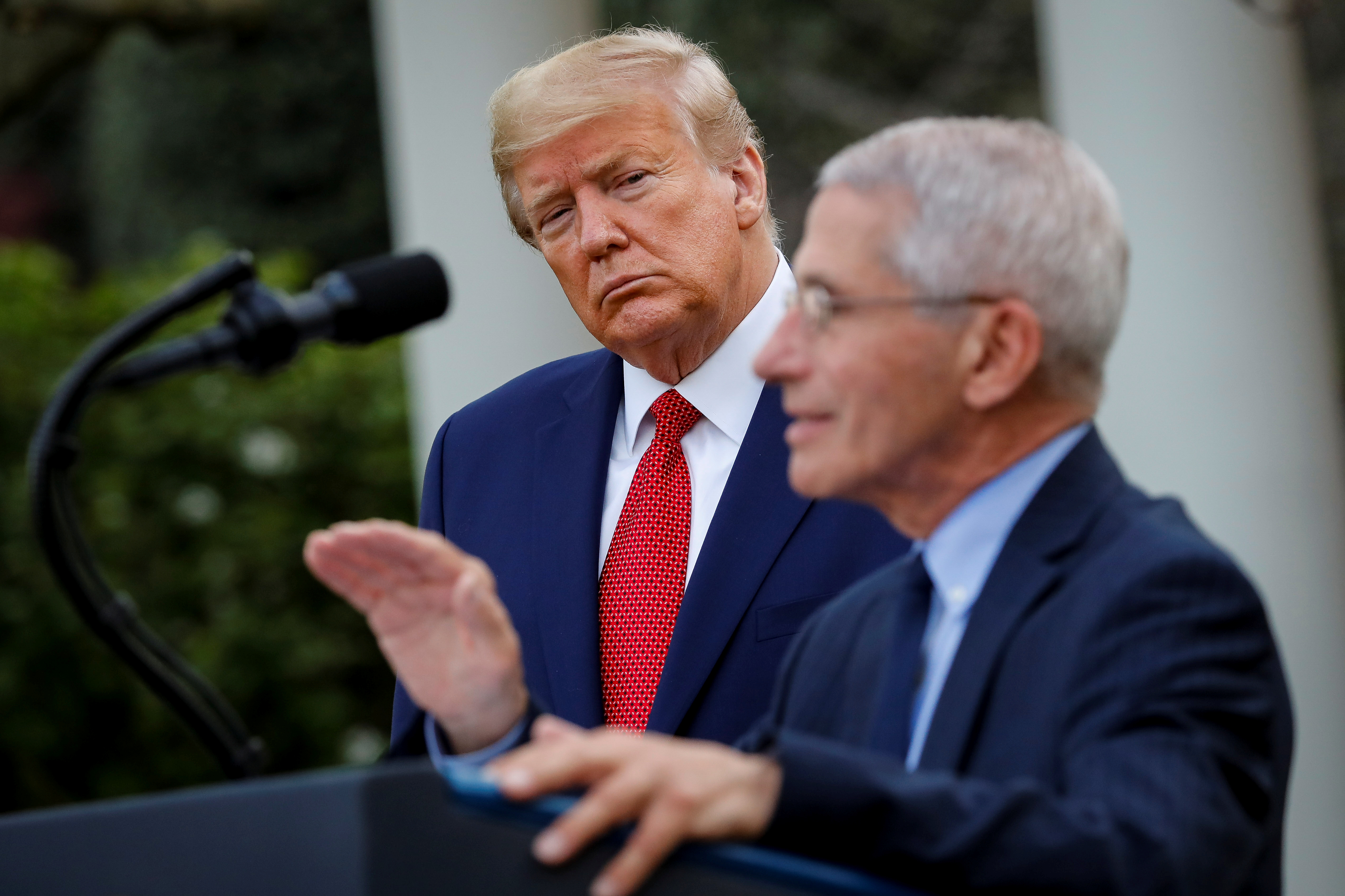 NIH National Institute of Allergy and Infectious Diseases Director Anthony Fauci speaks as U.S. President Donald Trump listens during a news conference in the Rose Garden of the White House in Washington, U.S., March 29, 2020.