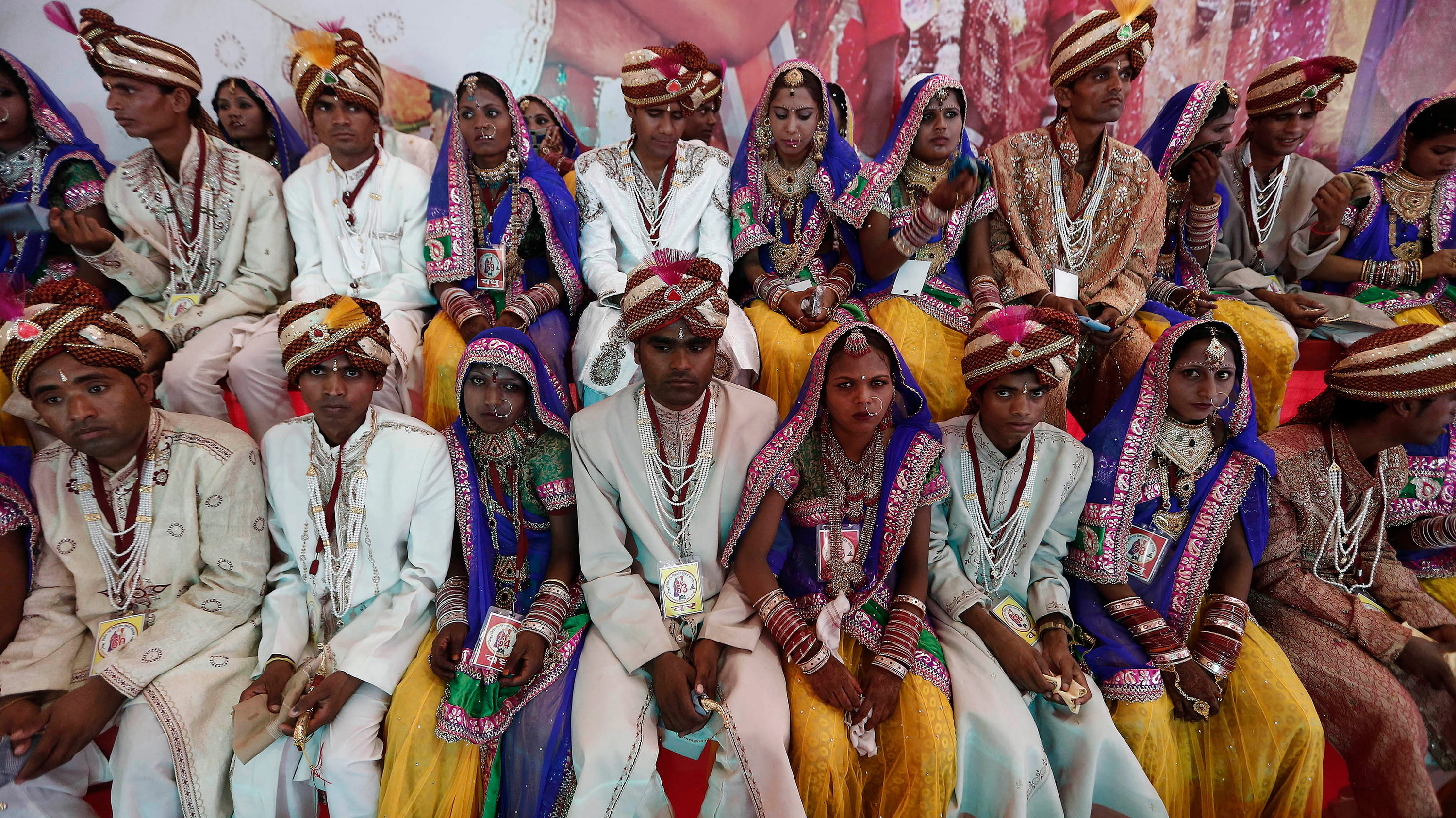 The photo shows a huge number of couples in fancy wedding garb.