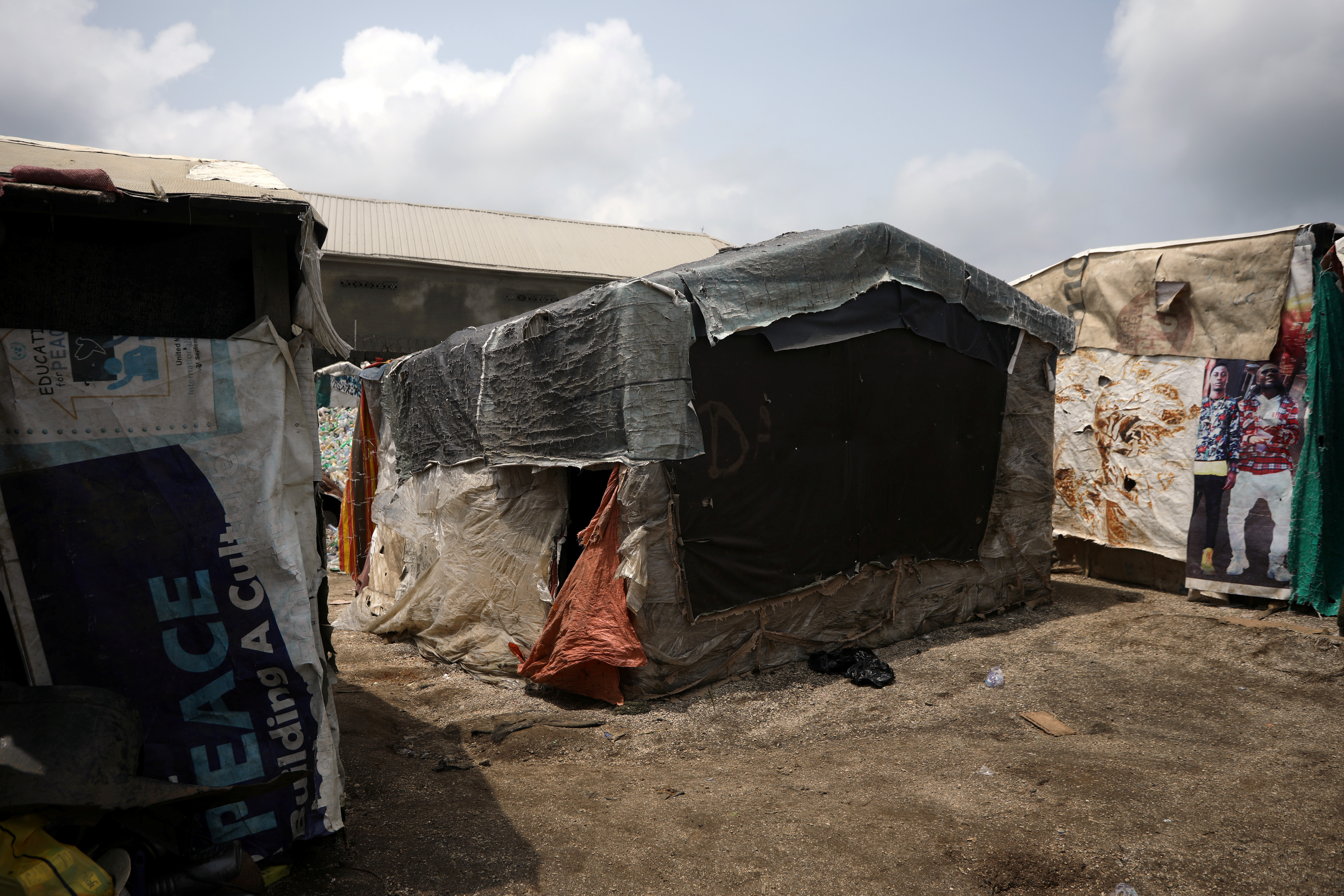 A house with plastic covering is seen in one of the overpopulated settlements in Abuja, Nigeria, on September 23, 2019.