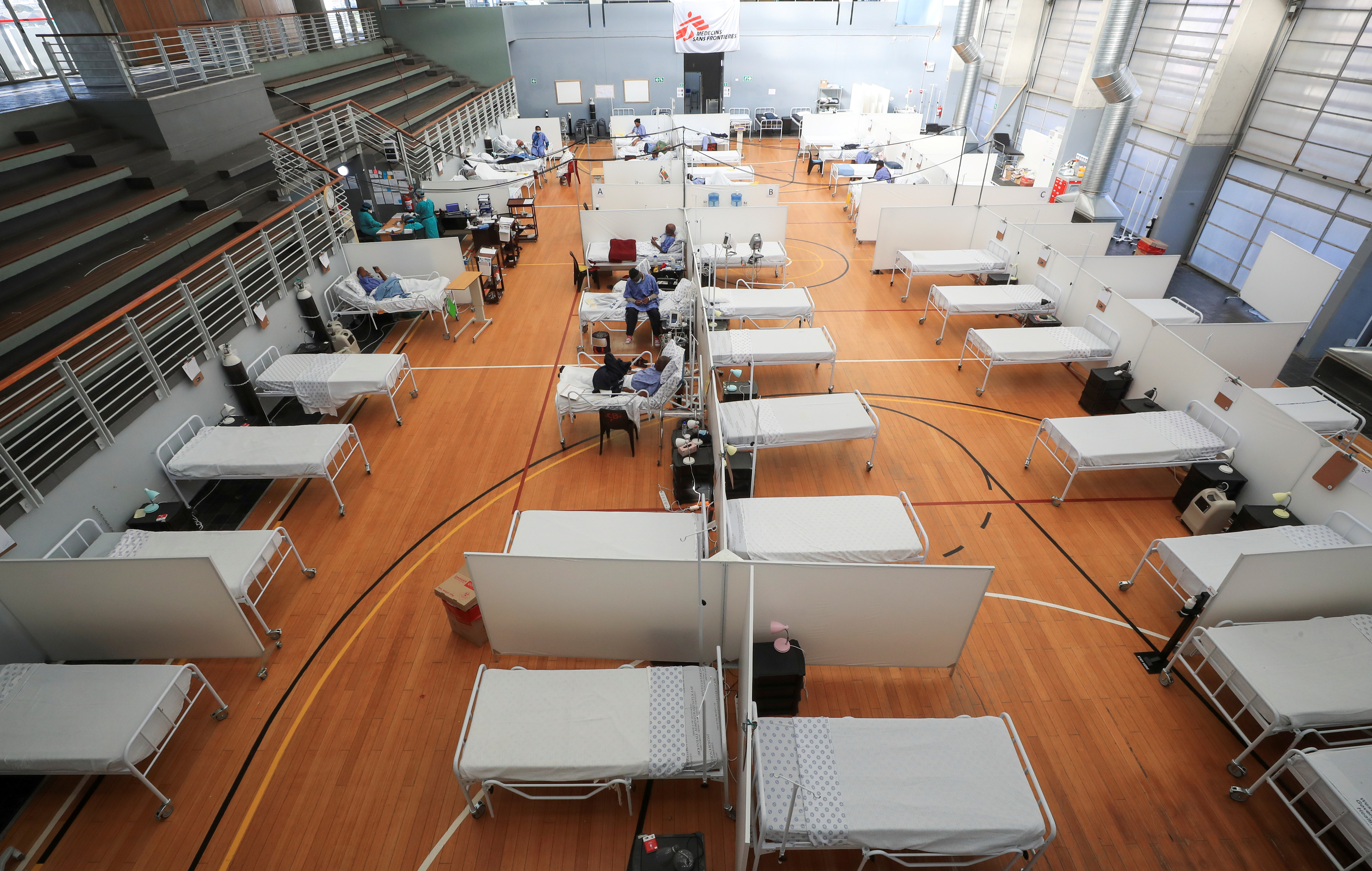 Beds are seen at a temporary field hospital set up in a sports complex by Medecins Sans Frontieres (MSF) during the coronavirus disease (COVID-19) outbreak in Khayelitsha township near Cape Town, South Africa, July 21, 2020