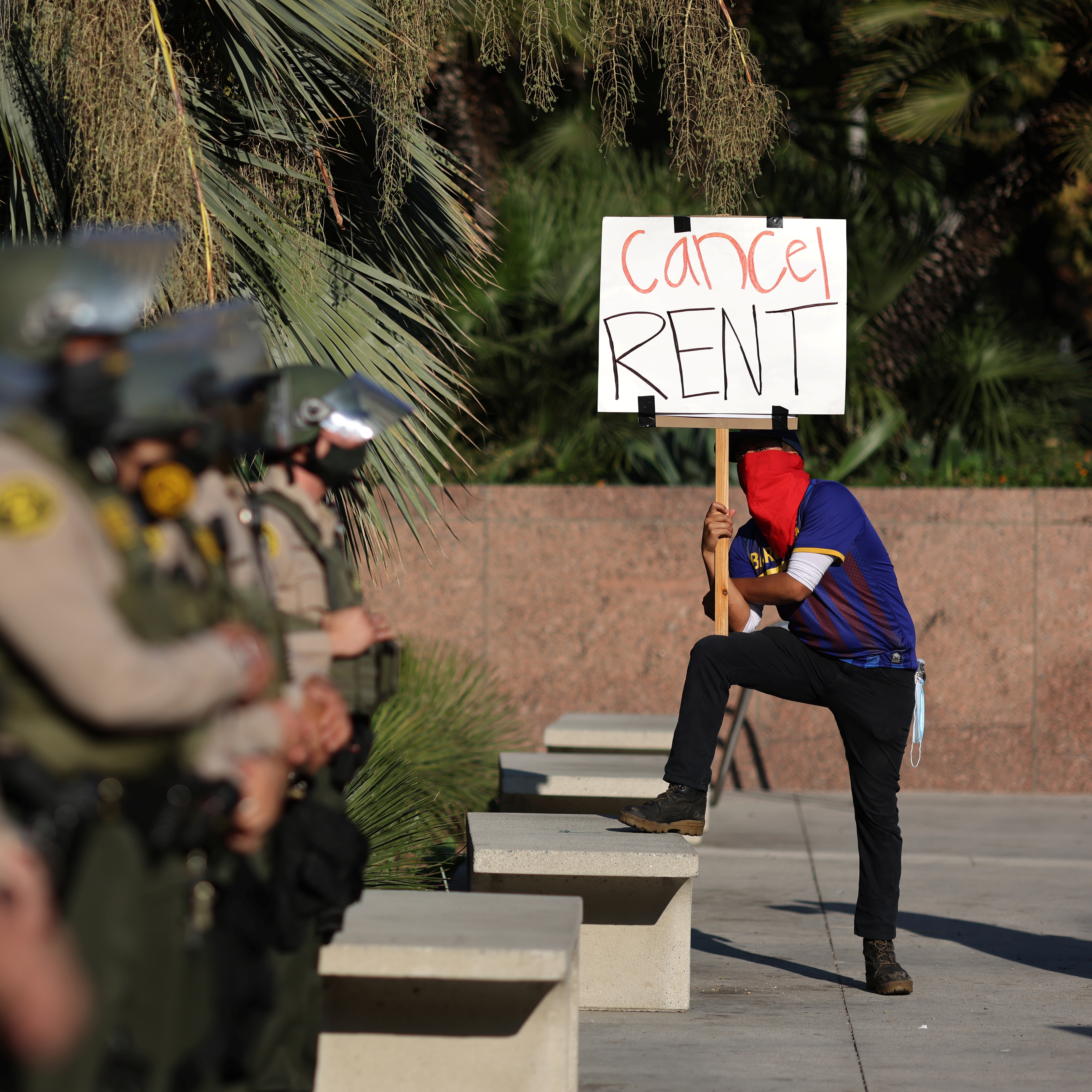 Tenants and housing rights activists protest for a halting of rent payments and mortgage debt as sheriff's deputies block the entrance to the courthouse in Los Angeles, California on October 1, 2020.