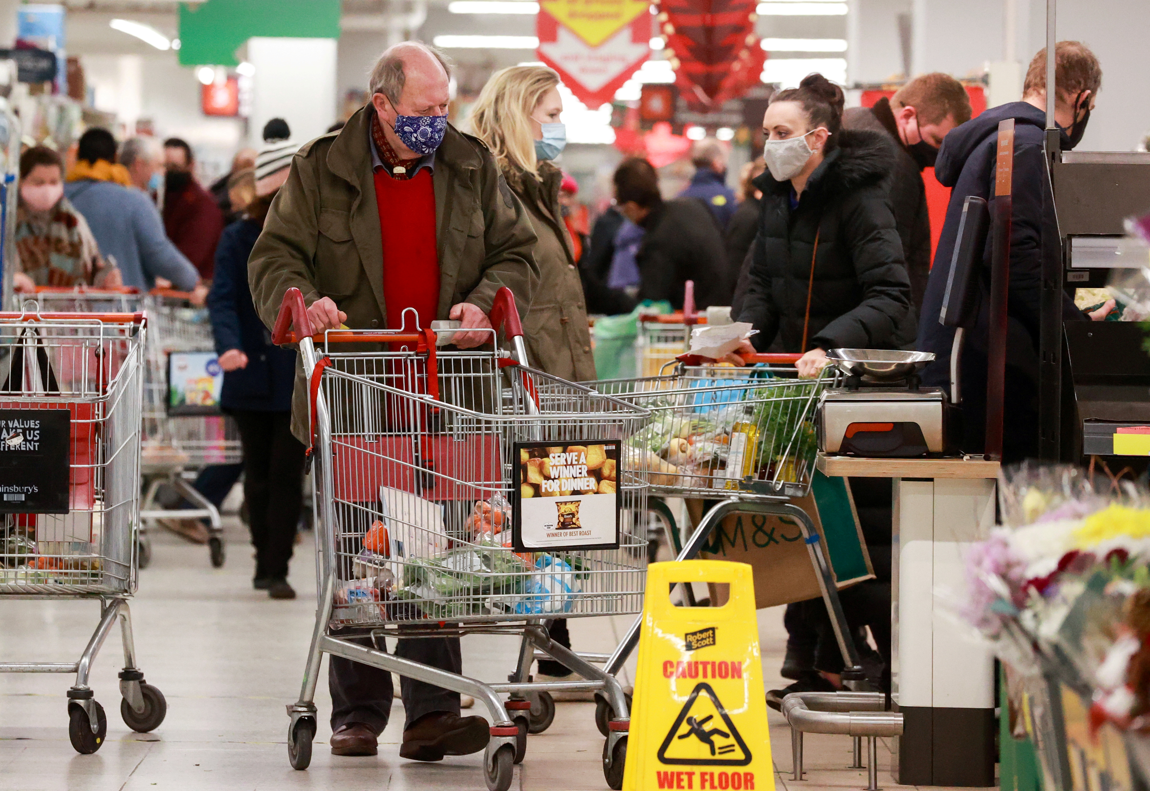 People shop at a Sainsbury's store, amid the coronavirus disease (COVID-19) outbreak, in London, Britain December 22, 2020.