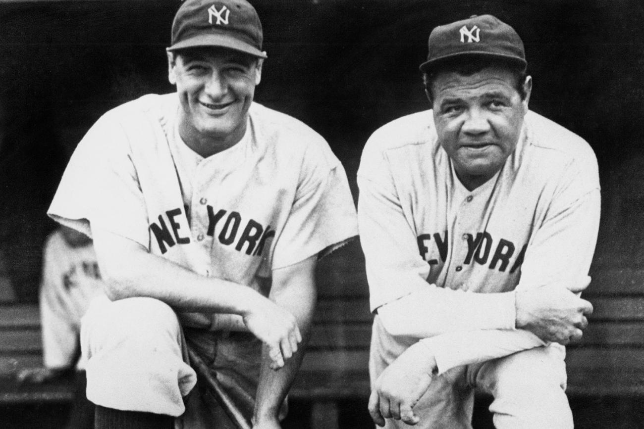 """Lou Gehrig, pictured with New York Yankees teammate Babe Ruth, was called the """"Iron Horse"""" of baseball for playing in 2,130 consecutive games before his forced retirement from the game that loved him. The photo shows Lou Gherig in happier times leaning on one knee propped on a dugout bench next to the Babe. GETTY PHOTO."""