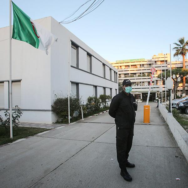 A security guard stands at attention at a hotel near Algiers, Algeria on Feb 4, 2020—where people evacuated from the Wuhan area in China are quarantined as a preventive measure because of coronavirus. Photo shows a guard wearing a face mask. REUTERS/Ramzi Boudina
