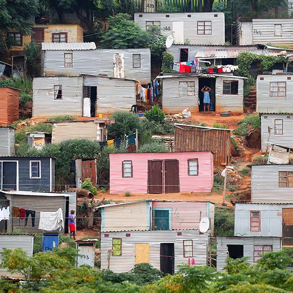 A general view of shacks during a nationwide twenty-one-day pandemic lockdown in an attempt to contain coronavirus infections in Umlazi township near Durban, South Africa, on March 31, 2020. The photo shows a hillside covered with tin shacks, some colorfully painted. REUTERS/Rogan Ward