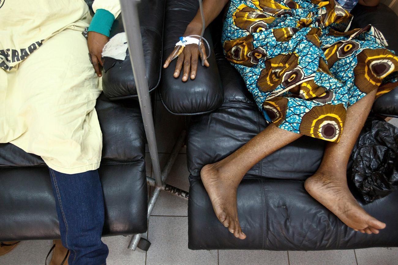 People sit in a chemotherapy ward while undergoing treatment for cancer at the Korle Bu Teaching Hospital in Accra, Ghana on April 24, 2012. Most of Africa's 2,000 languages have no word for cancer. Picture shows two people in comfortable chairs from the chest down. at least one of them has an IV in her arm, presumably an infusion of chemo meds. REUTERS/Olivier Asselin