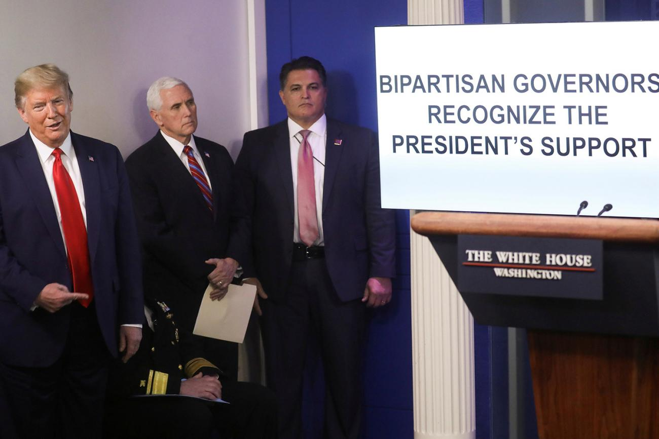 "The photo shows the president and vice-president standing with others next to a large video screen that has the words, ""BIPARTISAN GOVERNORS RECOGNIZE THE PRESIDENT'S SUPPORT."""