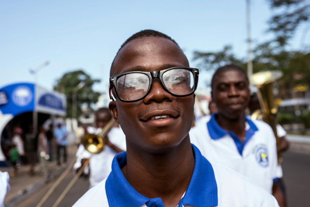 Ebola survivor Musa Pabai walks in an Ebola Survivors Valentine's Day parade in Monrovia, Liberia, on February 14, 2015. Pabai survived an outbreak that killed nearly ten thousand people across West Africa. Picture shows Musa smiling at the camera as he walks in the parade. REUTERS/Ricci Shryock