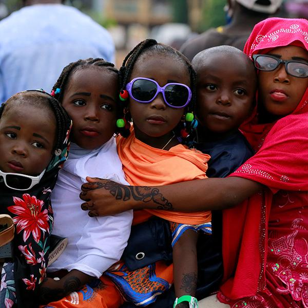 Children are seen on a bike after Muslims in Nigeria perform Eid prayer following the global outbreak of coronavirus disease (COVID-19) in Nasarawa May 24, 2020. The photo shows four children crammed together on a bike. REUTERS/Afolabi Sotunde