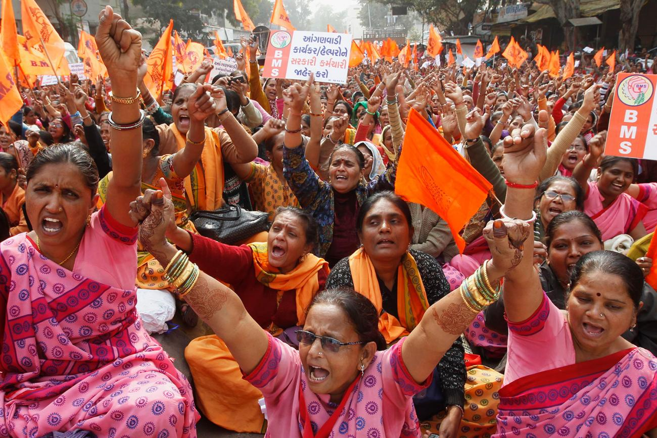 Anganwadi center workers at a protest rally in Ahmedabad, India, on December 24, 2013. There are more than 1.3 million such centers in India with three million workers. The proto shows a huge crowd, nearly all women, shouting and protesting at a crowded rally. REUTERS/Amit Dave