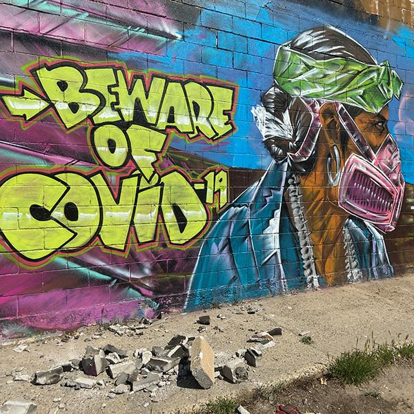 A mural warns residents of the danger of coronavirus disease (COVID-19) outbreak on the Navajo reservation, in Shiprock, New Mexico, U.S., April 8, 2020. Picture shows an amazing mural of a man wearing a mask painted on the side of a wall. REUTERS/Andrew Hay