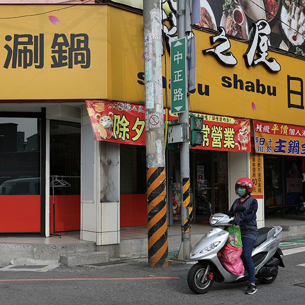 Taoyuan health worker Wang Tsui-lien rides a scooter to deliver care packages and to check on people who have been ordered to be under self-quarantine, in Taoyuan, Taiwan, on March 25, 2020. Photo shows a motorcycle on an abandoned street in an urban setting. REUTERS/Ann Wang