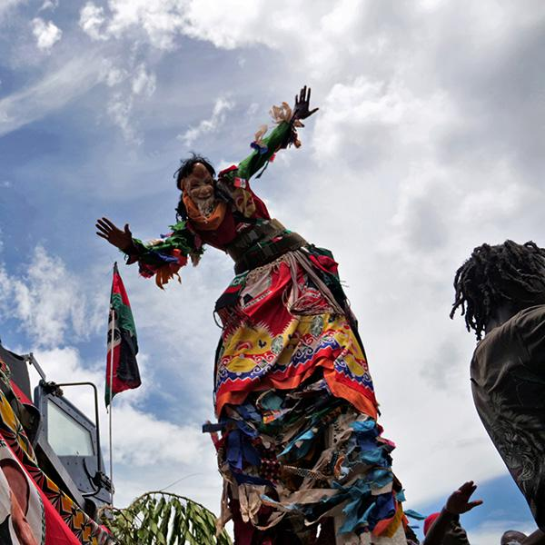 Opposition supporters celebrate in Lilongwe, Malawi, on February 4, 2020 after a court annulled the May 2019 presidential vote that declared Peter Mutharika the winner—ordering a new vote June 23. The photo shows a man in a stilt costume dancing. This is a striking photo. REUTERS/Eldson Chagara