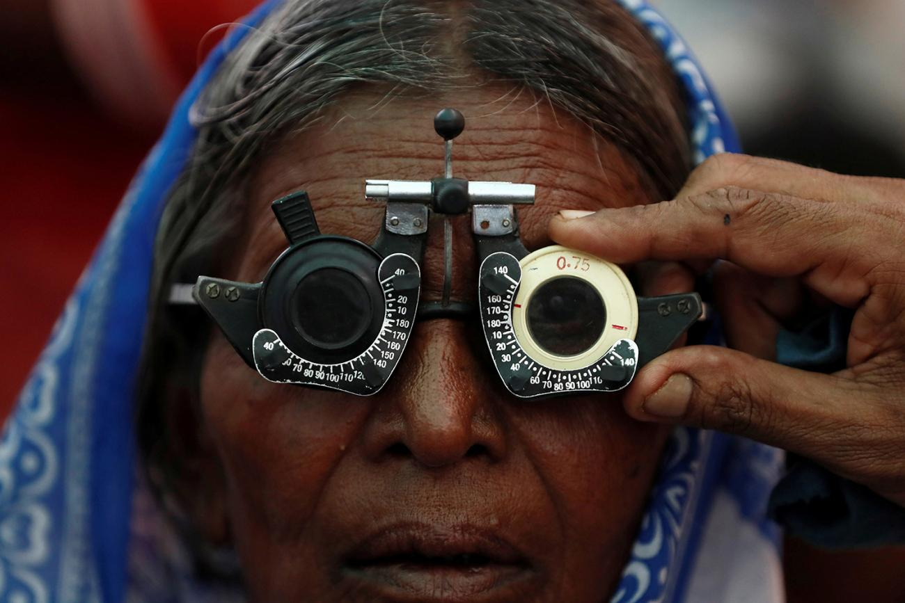 A woman gets her eyes tested at a free eye-care camp on the occasion of Indian politician Babasaheb Ambedkar's death anniversary in Mumbai, India, December 6, 2019. The photo shows an older woman with testing glasses on her face. REUTERS/Francis Mascarenhas