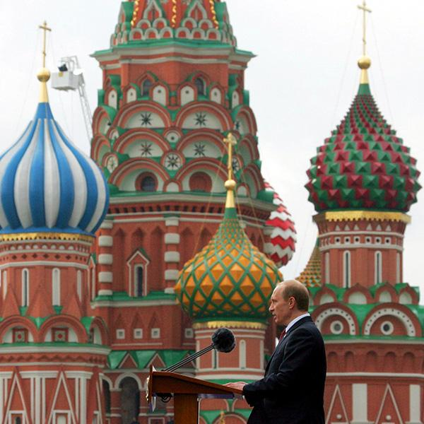 An earlier Victory Day: Russian President Vladimir Putin speaks during a military parade in Red Square in Moscow, May 9, 2005. The photo shows Putin in profile in front of St.Basil's Cathedral in Red speaking at a podium. REUTERS/Grigory Dukor