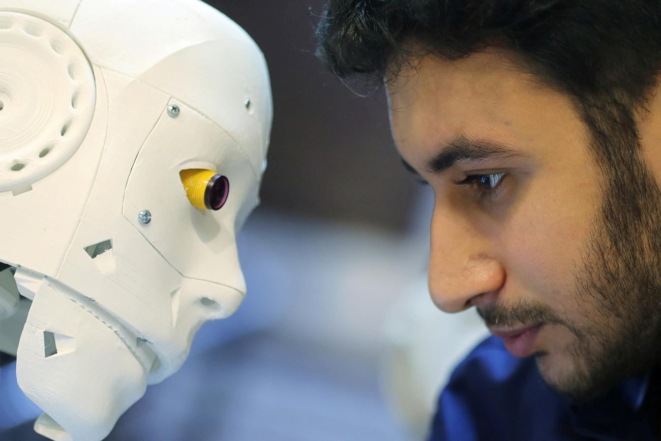 The remote-controlled robot built by Egyptian mechanical engineer Mahmoud El komy to test people for coronavirus by running PCR tests, limiting exposure to suspected cases, is pictured in Cairo, Egypt, on June 12, 2020. Picture shows the robot and inventor eye-to-eye. REUTERS/Mohamed Abd El Ghany