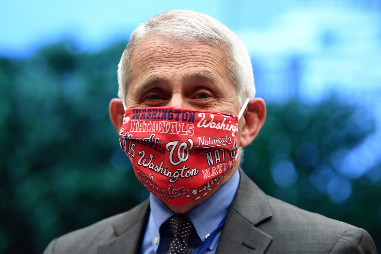 The photo shows Fauci smiling from behind a mask emblazoned with a Washington Nationals design pattern.