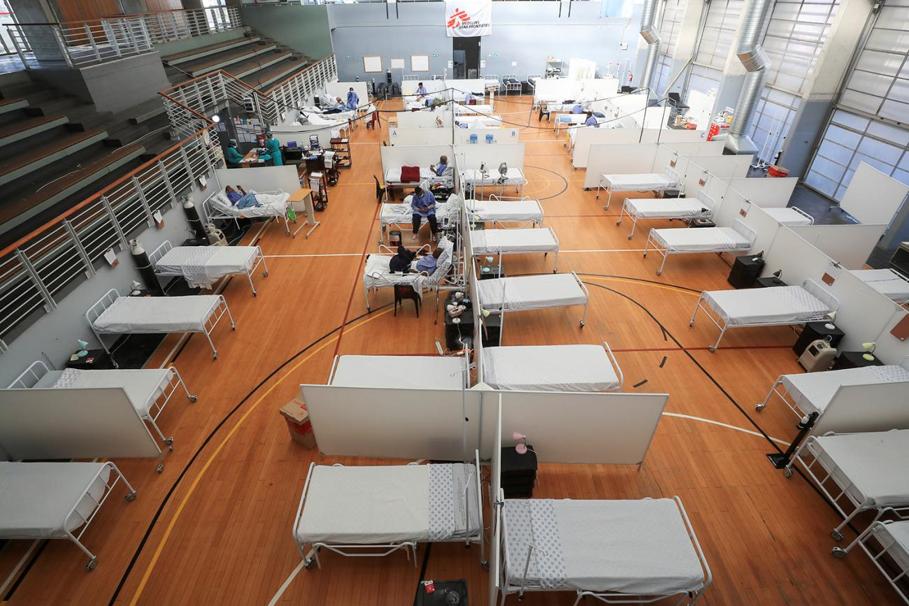 Beds at a temporary field hospital set up in a sports complex by Medicines Sans Frontieres during the coronavirus outbreak in Khayelitsha township near Cape Town, South Africa, on July 21, 2020. The photo shows a large gymnasium with lots of beds in rows. REUTERS/Mike Hutchings