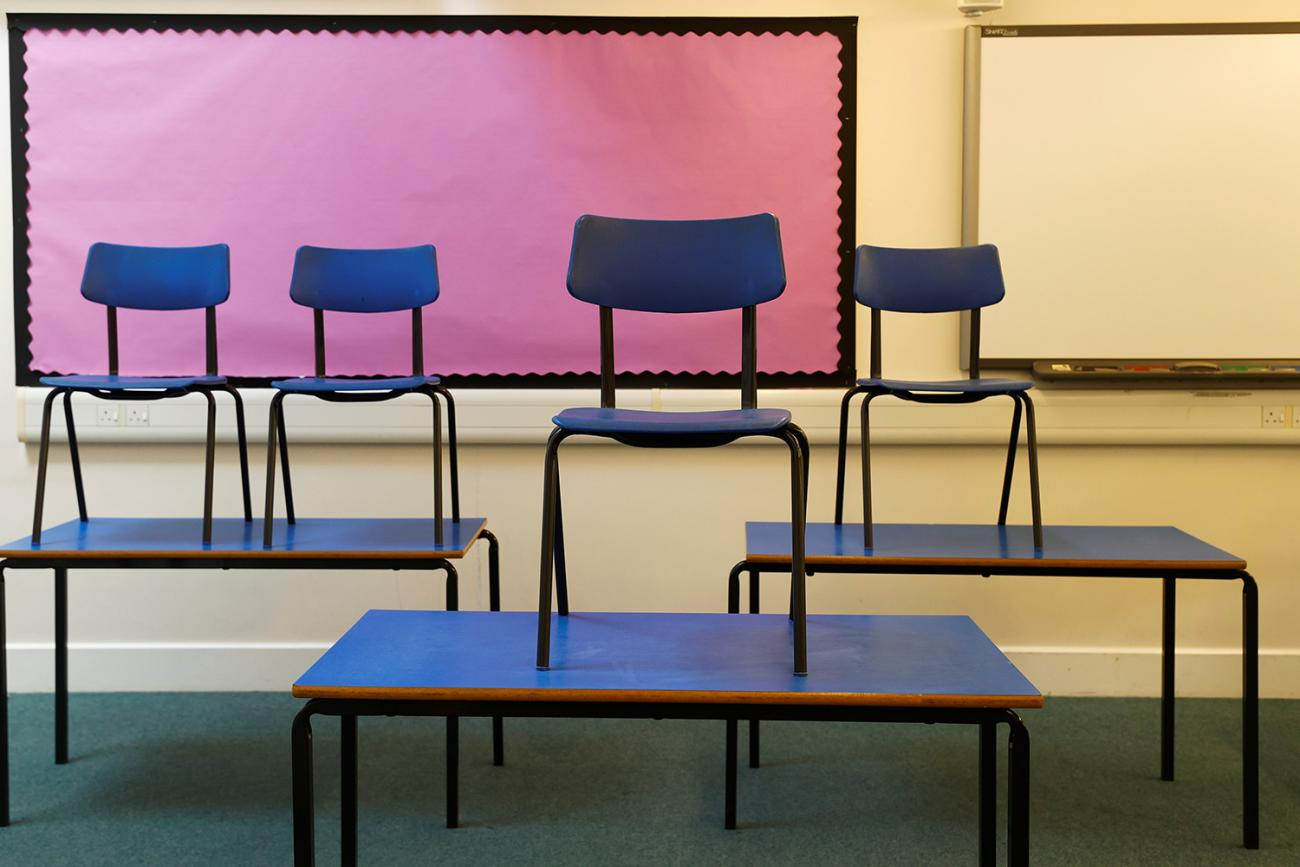 Chairs are pictured on top of tables in a classroom at Watlington Primary School during the last day of school, amid the coronavirus outbreak in Watlington, Britain, on July 17, 2020. The photo shows a number of tables with chairs stacked upon them. REUTERS/Eddie Keogh