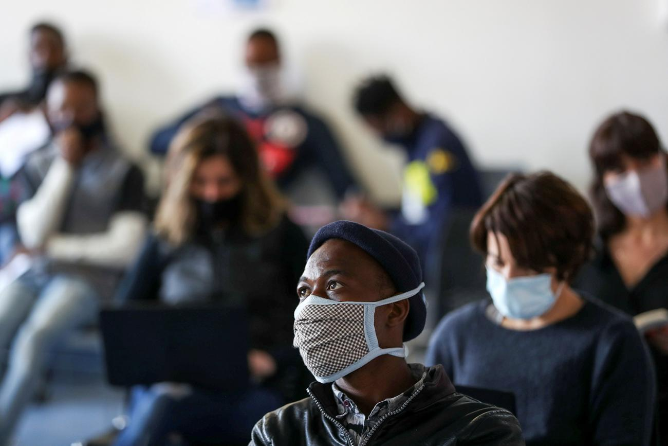 Volunteers wait for their names to be called before testing and taking part in a COVID-19 clinical trial at the Wits RHI Shandukani Research Centre in Johannesburg, South Africa, on August 27, 2020. Picture shows a waiting room full of people. REUTERS/Siphiwe Sibeko