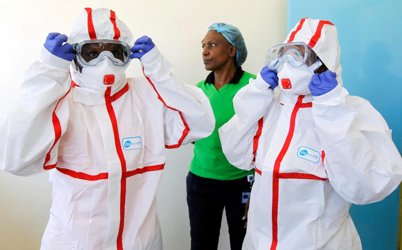 Kenyan nurses wear protective gear during a demonstration of preparations for any potential coronavirus cases at the Mbagathi Hospital, isolation centre for the disease, in Nairobi, Kenya March 6, 2020.