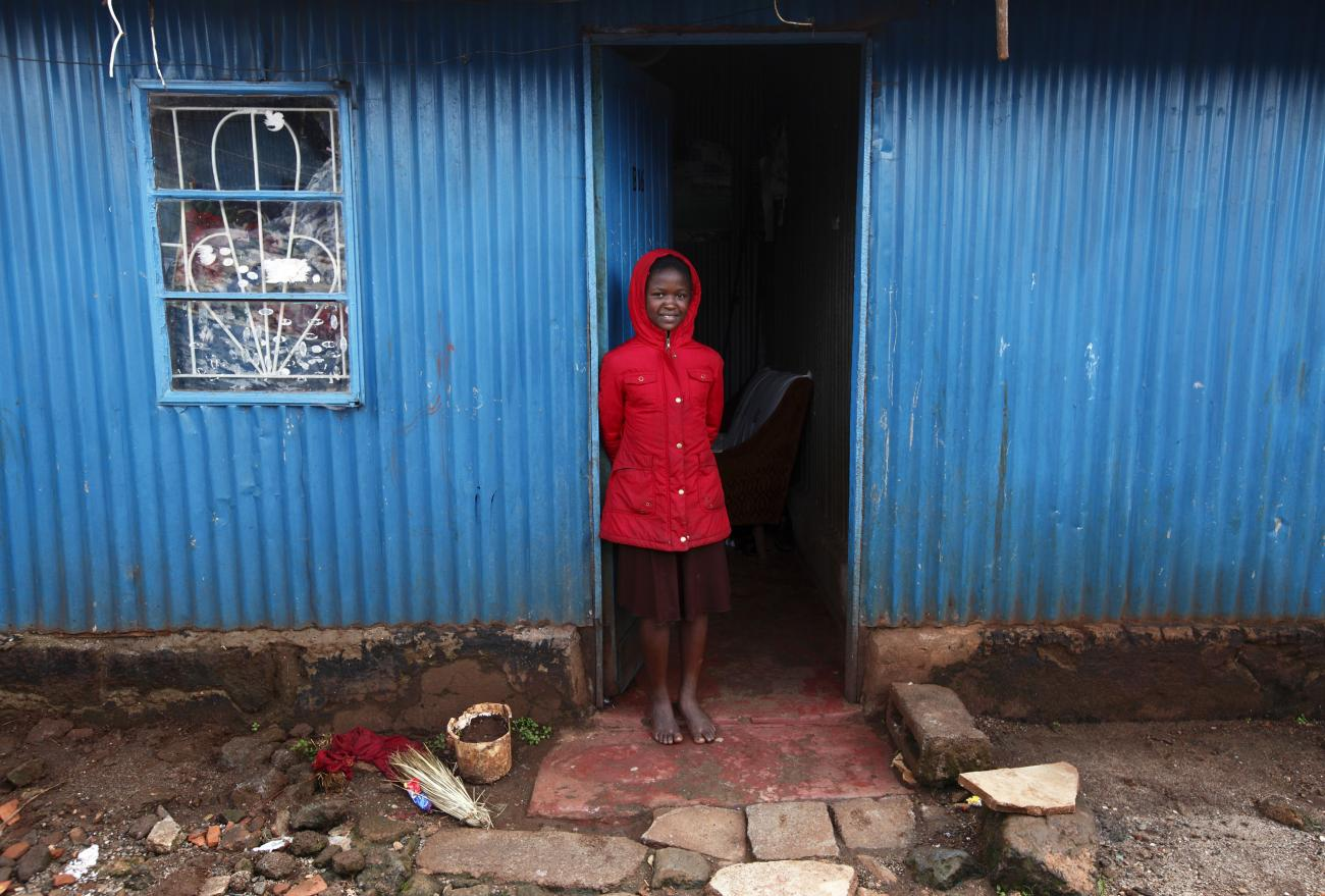 DOCUMENT DATE: April 29, 2013 Fanice Cecilia Nyansiaboka, 12, a participant in the Jesuit-run Upendo programme, stands in the doorway of the home she shares with her father in the Kangemi slum of Nairobi April 23, 2013.
