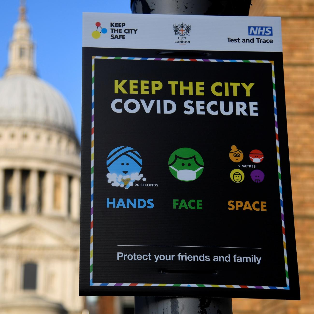 A public health information sign is seen with St. Paul's Cathedral seen behind amidst a lockdown during the spread of the coronavirus disease pandemic, London, Britain, January 7, 2021.