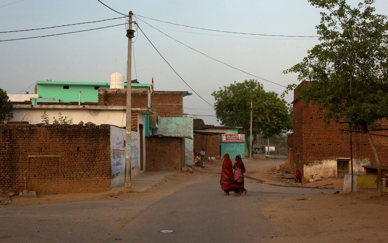 DOCUMENT DATE: April 21, 2020 Women walk through an empty street during nationwide lockdown in India to slow the spread of the coronavirus, in Jugyai village in the central state of Madhya Pradesh, India, April 8, 2020.
