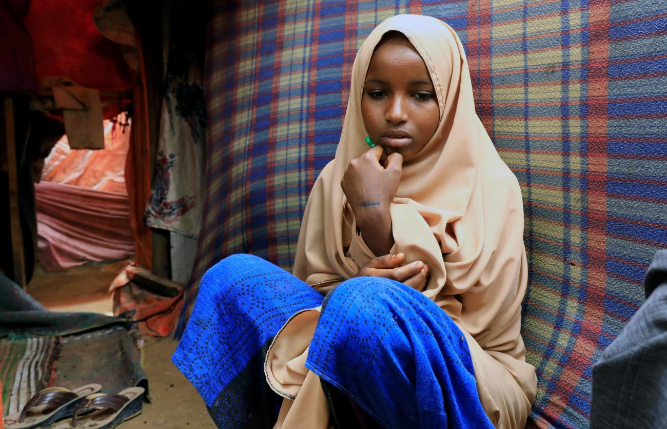 A Somali girl sits inside her mother's makeshift shelter after she ran away from a suspected forced marriage at the Alafuuto camp for internally displaced persons in Garasbaaley district of Mogadishu, Somalia on August 14, 2020.